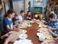 Neepawa and Minnedosa parishes - March 2015: Catechism teacher, Pat Gawaziuk, teaching catechism children and their parents how to make Pysanky.