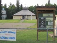 "Historical kiosk erected beside highway in the Summer 0f 2014 showing the famous ""Mountain Road Church""."